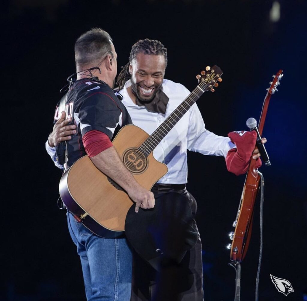 Larry Fitzgerald presents Garth Brooks with a custom jersey during Brooks' performance at State Farm Stadium in Glendale, AZ on March 23, 2019. Photo courtesy of the artist.