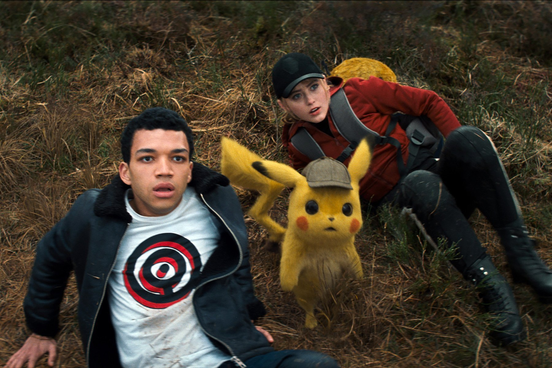 Justice Smith, Kathryn Newton and Ryan Reynolds in Pokemon Detective Pikachu