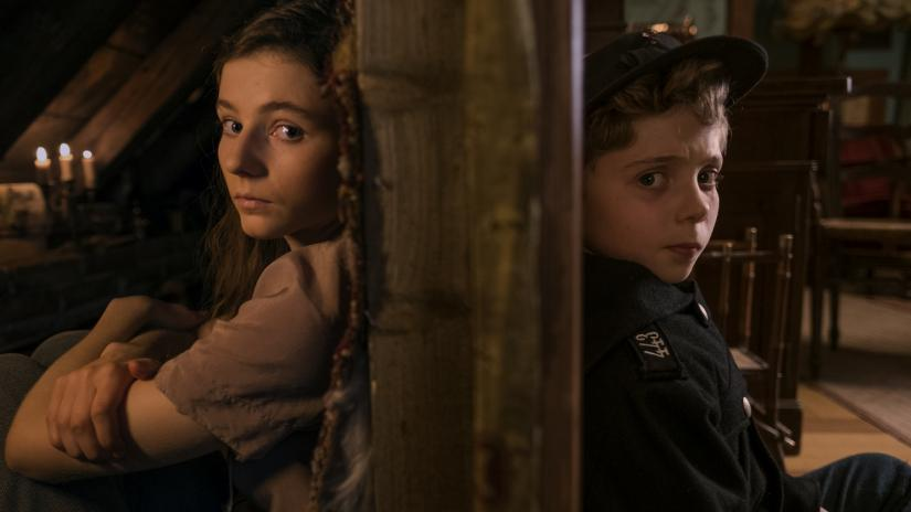 Thomasin McKenzie and Roman Griffin Davis in Jojo Rabbit