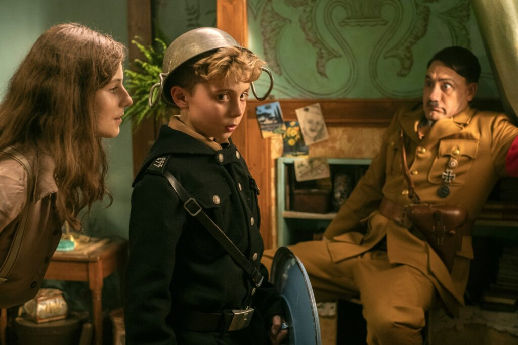 Thomasin McKenzie, Roman Griffin Davis and Taika Waititi in Jojo Rabbit